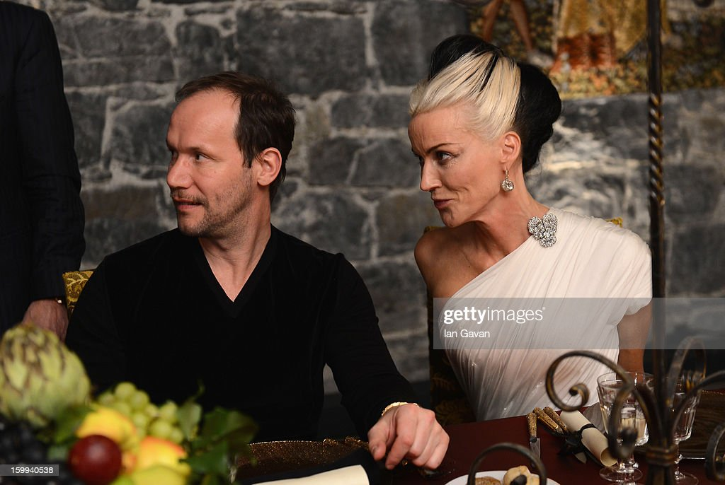 Friend of the Roger Dubuis brand Daphne Guinness and Alvaro Maggini (L), Creative Director attend the Excalibur Dinner during the 23rd Salon International de la Haute Horlogerie at Caves des Vollandes on January 22, 2013 in Geneva, Switzerland.