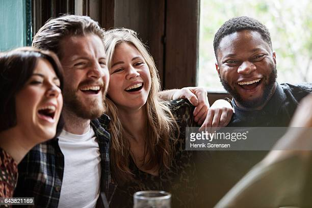 friend posing for a picture - pub stock pictures, royalty-free photos & images