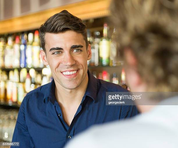 Friendly bartender and customer