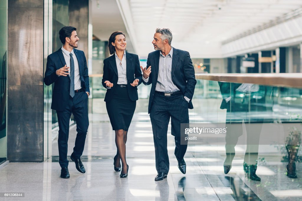 Friendly business discussion : Stock Photo