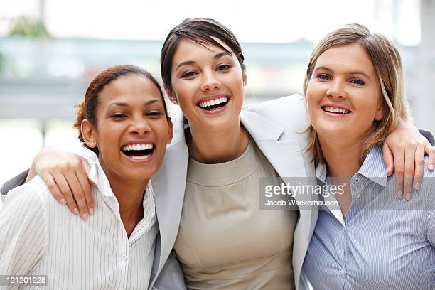 Friendly businesswoman standing with her colleagues