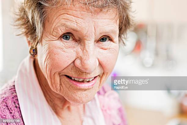 Friendly, contented-looking senior woman smiles gently