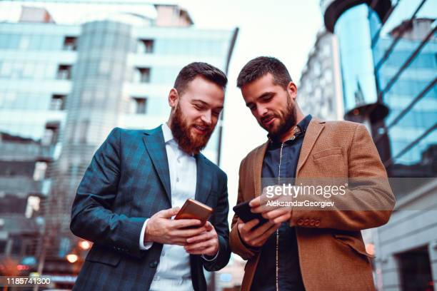 friendly coworkers exchanging phone numbers - telephone number stock pictures, royalty-free photos & images