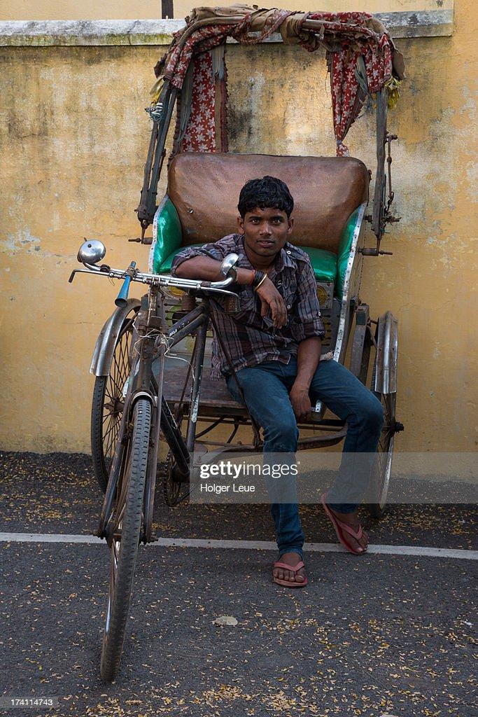 Friendly cycle rickshaw driver : Stock Photo