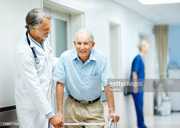 Friendly doctor assisting a senior man