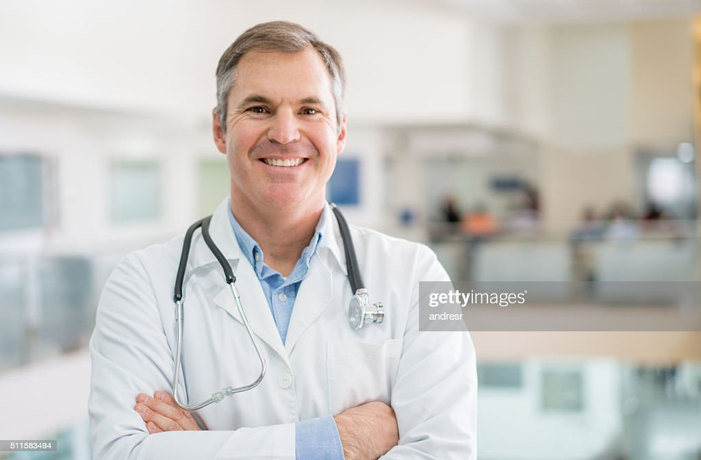 Friendly doctor at the hospital : Stock Photo
