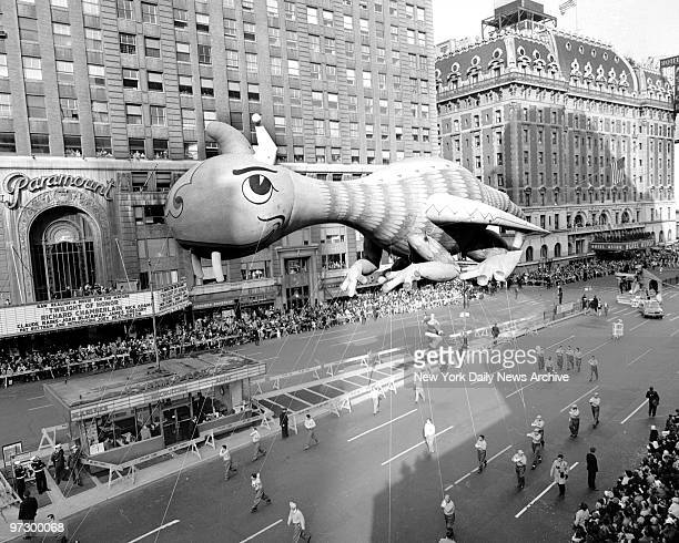 Friendly dragon floats over packed Times Square during the 37th annual Macy's Thanksgiving Day parade An estimated throng of 1000 spectators lined...