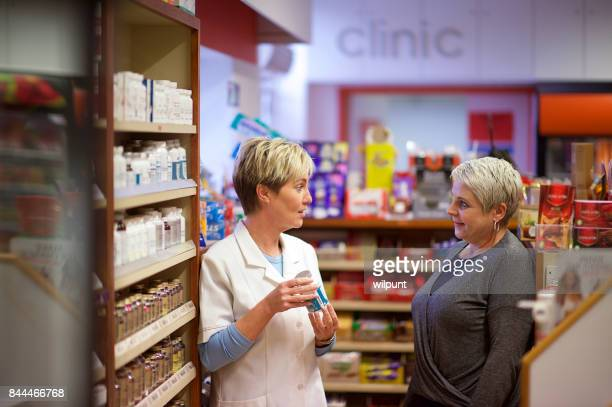 friendly female pharmacy help - generic drug stock pictures, royalty-free photos & images
