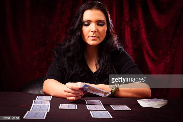 friendly fortune teller with tarot cards