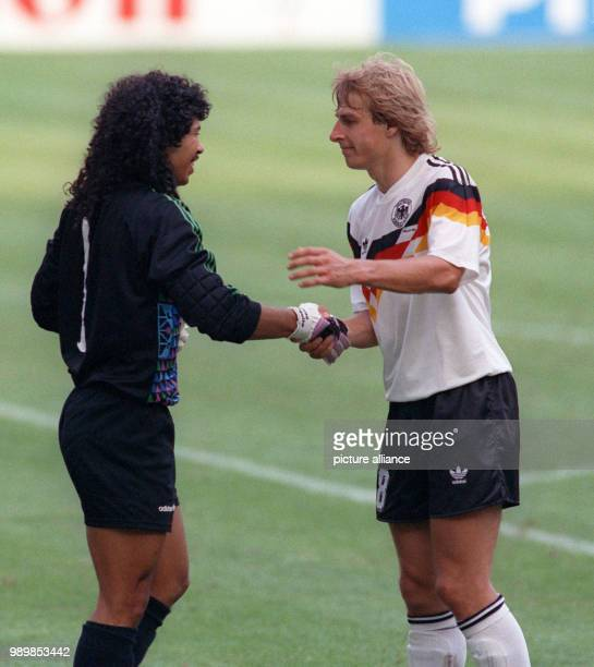 Friendly handshake between German striker Juergen Klinsmann and Colombia's goalkeeper Rene Higuita in Milan's GiuseppeMeazza stadium The match ends...