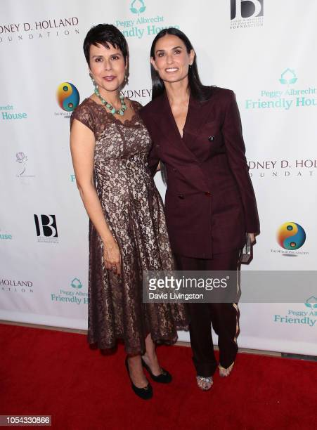 Friendly House executive director Monica Phillips and Demi Moore attend the Peggy Albrecht Friendly House's 29th Annual Awards Luncheon at The...