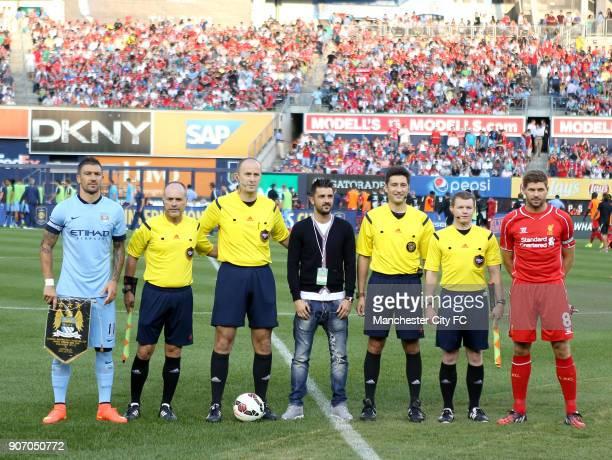 Friendly Liverpool v Manchester City Yankee Stadium Manchester City's Aleksandar Kolarov and Liverpool's Steven Gerrard line up alongside match...