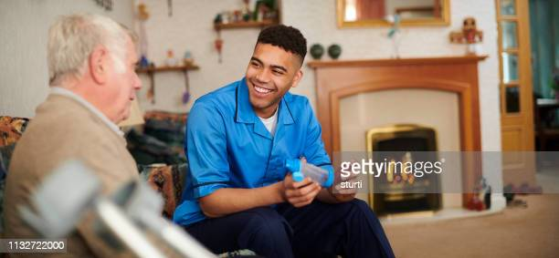 friendly male care nurse - social services stock pictures, royalty-free photos & images
