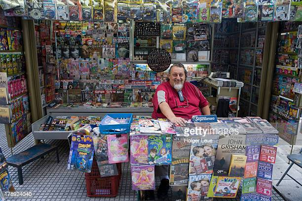 Friendly man at news stand