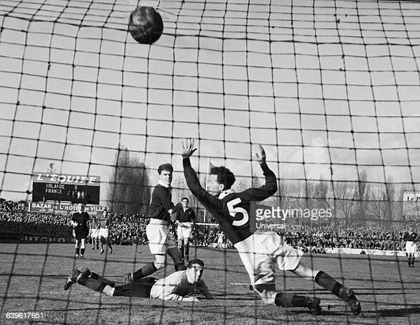 Friendly match between France and Northern Ireland Raymond Kopa scores the second goal for France On the field Northern Ireland's goalkeeper Norman...