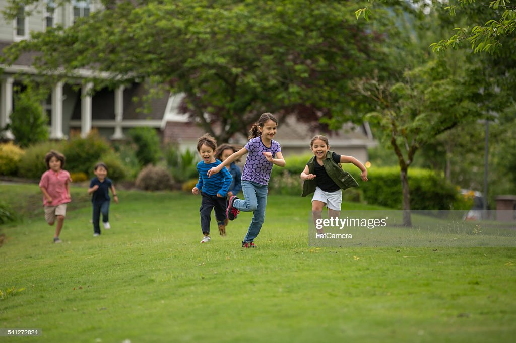 Friendly neighborhood children playing together outside : Stock Photo