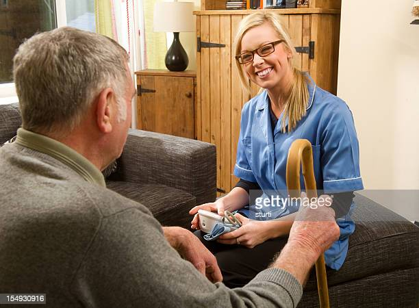 friendly nurse and elderly man - nhs staff stock pictures, royalty-free photos & images