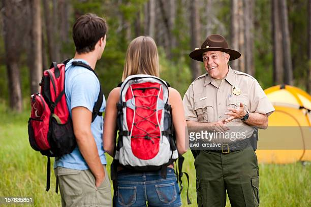 Friendly Park Ranger Helping Campers