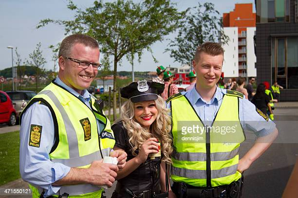friendly police officers in carnival - danish culture stock pictures, royalty-free photos & images