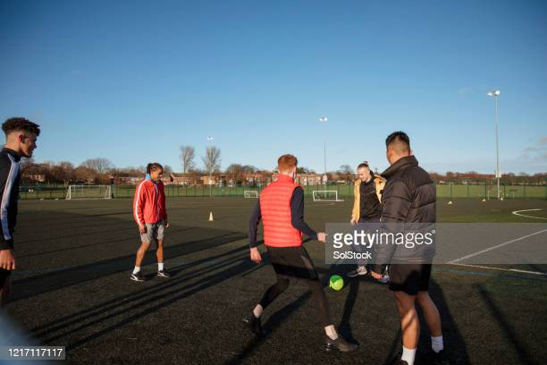 friendly practice - football stock pictures, royalty-free photos & images