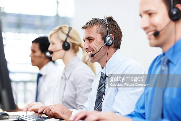 Friendly representatives with headsets in office
