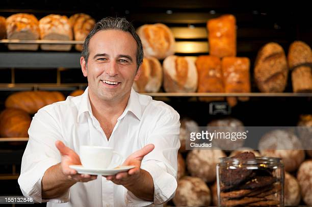 Friendly sales executive offering cup of coffee