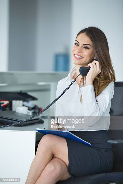 Friendly secretary/telephone operator in an office environment.