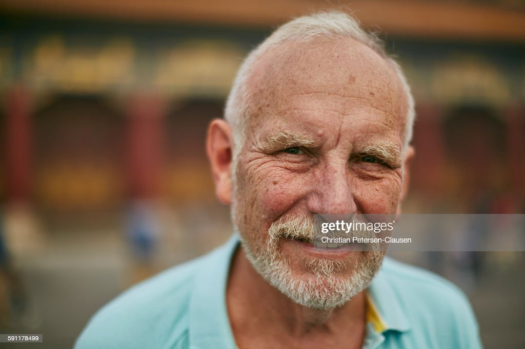 Friendly senior male at Forbidden City : Stock Photo