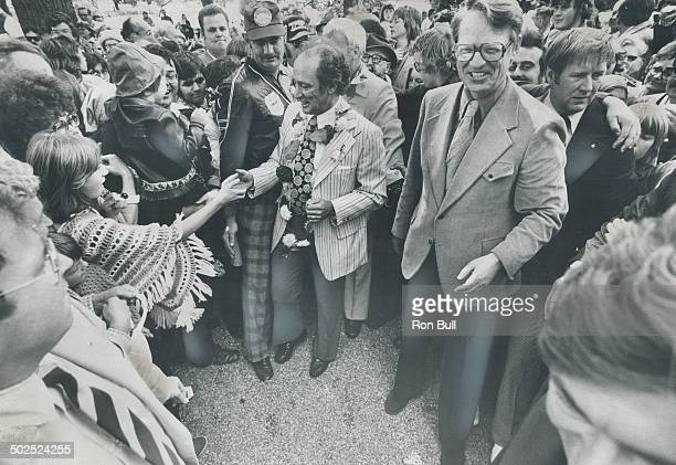 Friendly smiles were everywhere when Robert Nixon the Ontario Liberal leader was host to Prime Minister Pierre Trudeau at a picnic near Brantford on...