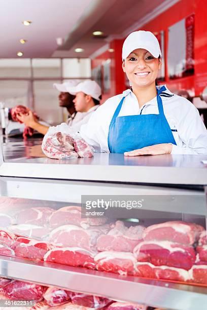 Friendly woman in a butchers shop