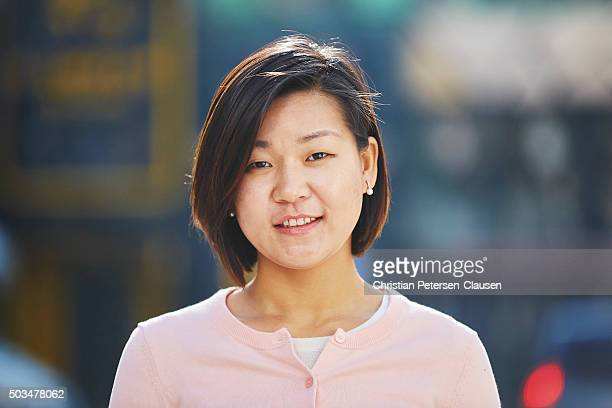 Friendly young Asian woman smiling