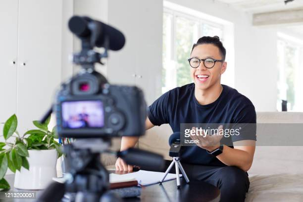 friendly young man vlogging - influencer stock pictures, royalty-free photos & images