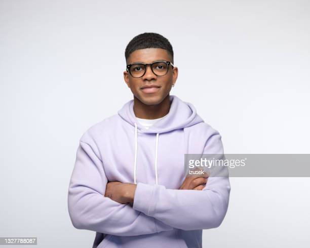 friendly young man wearing lilac hoodie - afro caribbean ethnicity stock pictures, royalty-free photos & images