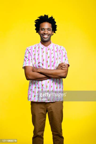 friendly young man wearing vintage shirt, portrait on yellow background - short sleeved stock pictures, royalty-free photos & images