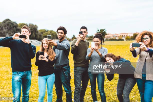friends addicted to the social media take a selfie