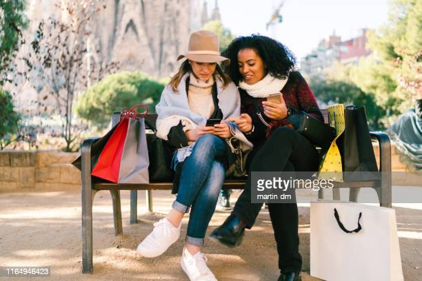 friends after shopping checking social media - buying stock pictures, royalty-free photos & images
