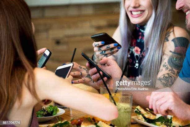 Friends all using smart phones