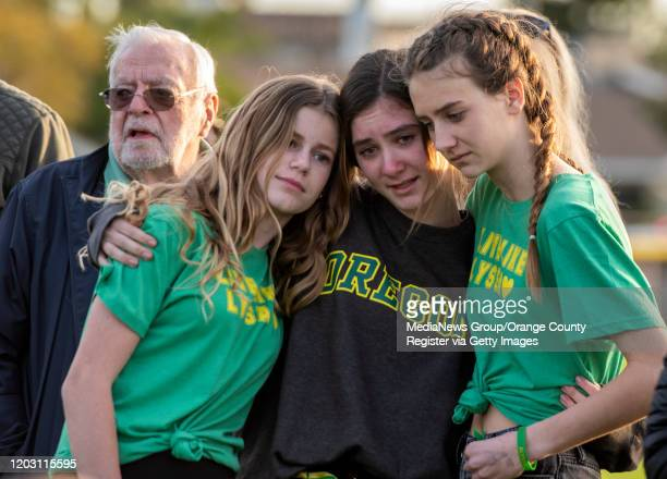 Friends and classmates of Alyssa Altobelli grieve during a vigil at Mariners Park in Newport Beach on Thursday January 30 2020 At left is Alyssa's...