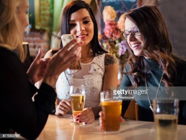 "friends and coworkers party in a bar. - ""martine doucet"" or martinedoucet stock pictures, royalty-free photos & images"