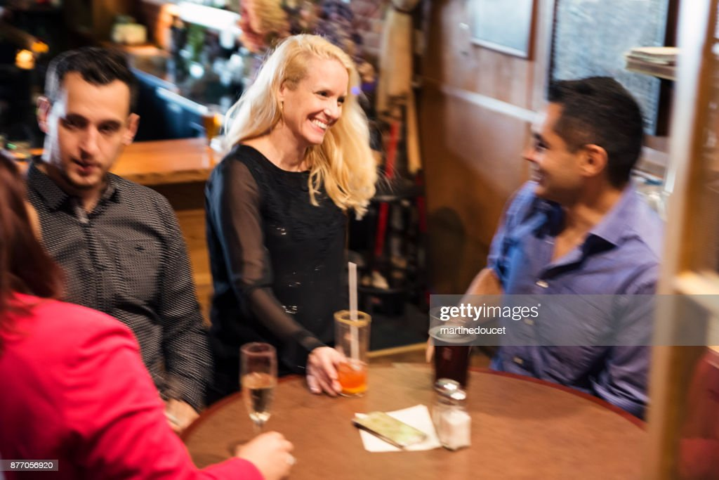 Friends and coworkers party in a bar. : Stock Photo