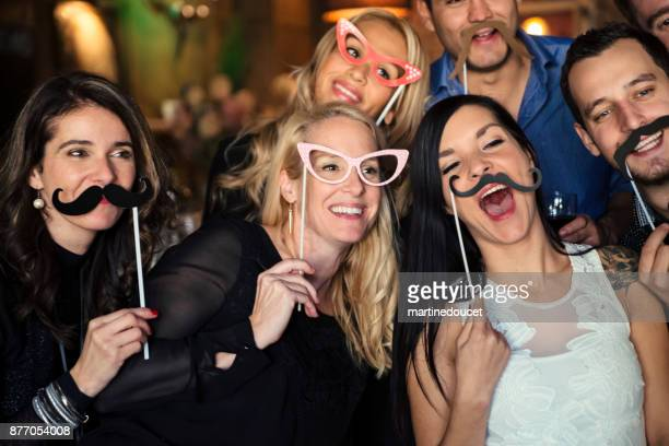 "friends and coworkers photo booth at a party in a bar. - ""martine doucet"" or martinedoucet stock pictures, royalty-free photos & images"