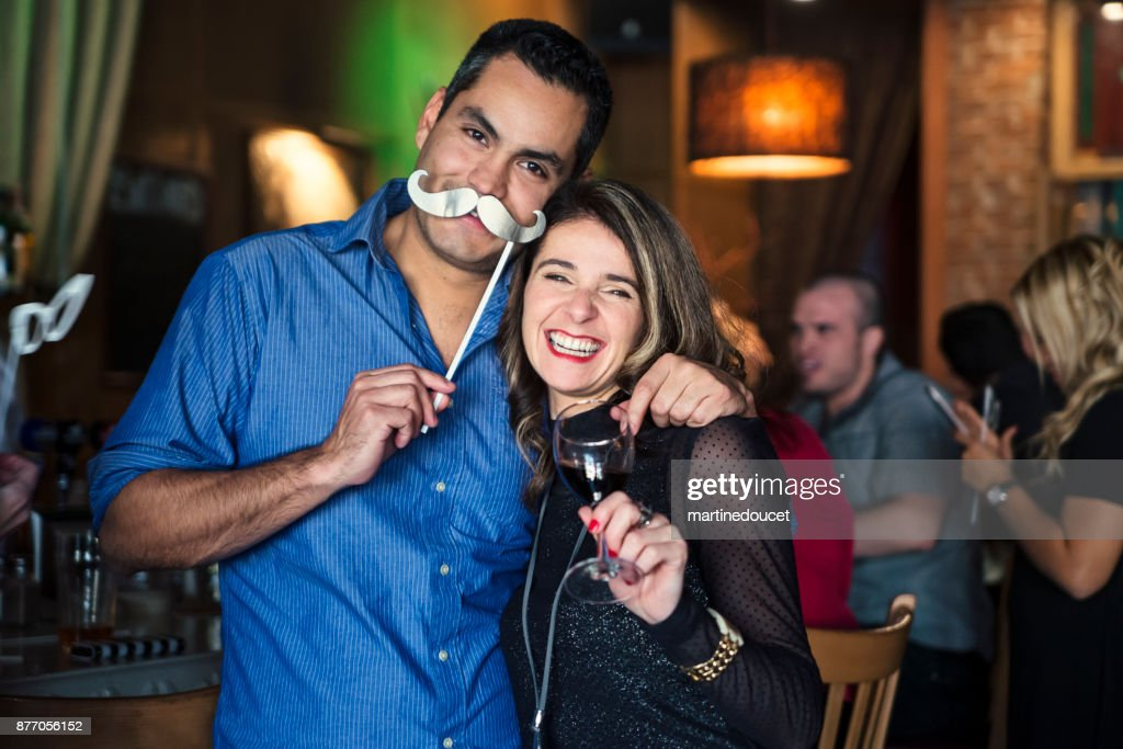 Friends and coworkers photo booth at a party in a bar. : Stock Photo