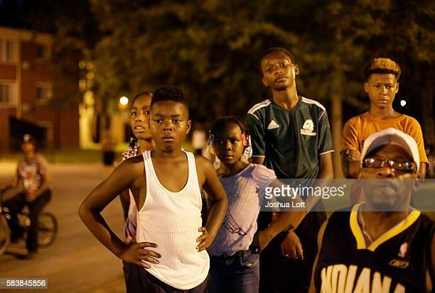Friends and family attend a vigil for Africa Bass who was killed as she walked through her apartment complex July 27 2016 in Chicago Illinois Bass is...