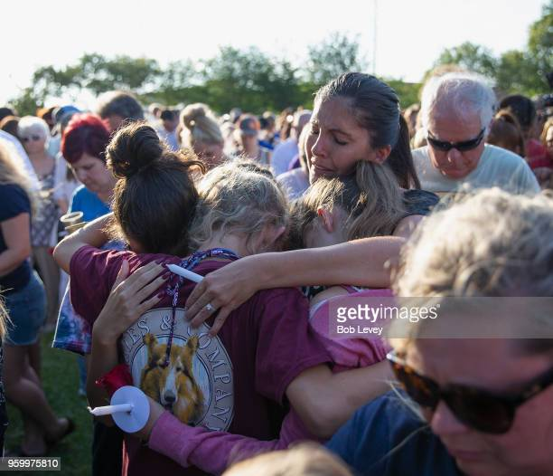 Friends and family attend a vigil held at the First Bank in Santa Fe for the victims of a shooting incident at Santa Fe High School where a shooter...