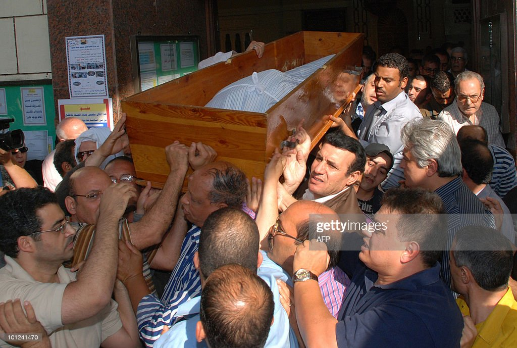 Friends and family carry the body of Egyptian screenwriter and journalist Osama Anwar Okasha during his funeral in Cairo on May 28, 2010 after he died earlier this morning in a hospital at the age of 69.