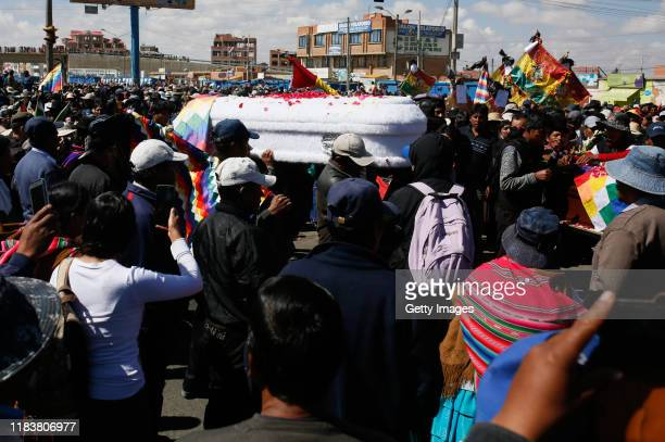 Friends and family carry the coffin of Antonio Ronaldo Quispe Ticona who was killed during clashes with police at the Senkata fuel plant as part of a...