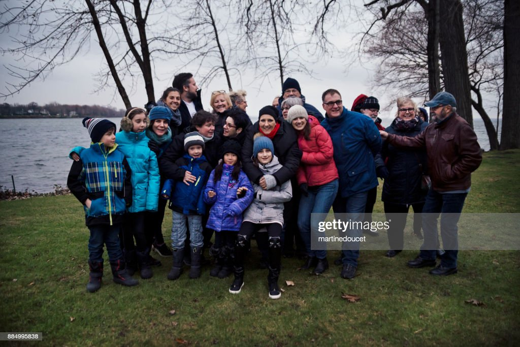 Friends and family celebrating life of cancer patient outdoors winter : Stock Photo