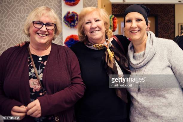 """friends and family celebration for cancer patient. - """"martine doucet"""" or martinedoucet stock pictures, royalty-free photos & images"""