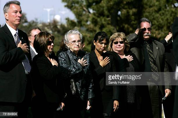 Friends and family cross their hearts during a prayer at the funeral of Captain Brian Freeman during a memorial service at Ft Rosecrans National...