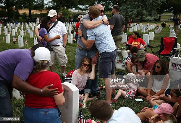 Friends and family gather around the gravesite of fallen soldier US Army Capt Ronald George Luce Jr who was was killed in Afghanistan in section 60...